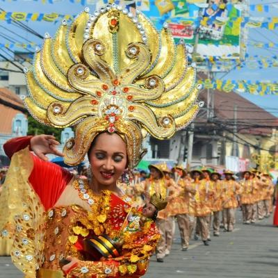 Projects Abroad volunteer work in the Philippines is ongoing as the locals celebrate a festival in the streets.